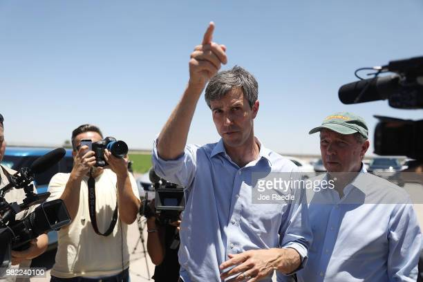 Rep Beto O'Rourke and US Senator Tom Udall speak to the media before taking a tour of a tent encampment near the TornilloGuadalupe Port of Entry on...