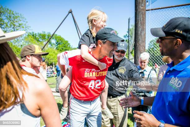 Rep Beto O'Rourke carries his daughter Molly during a fundraiser baseball game on April 14 2018 in Austin Texas O'Rourke is an El Paso Democrat...