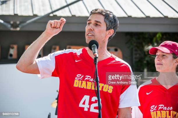 Rep Beto O'Rourke gives a speech alongside his wife Amy Hoover Sanders during a fundraiser baseball game on April 14 2018 in Austin Texas O'Rourke is...