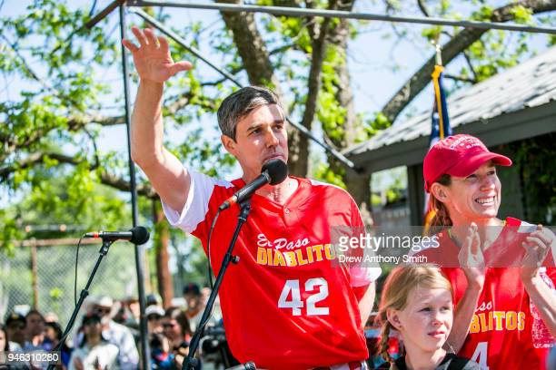 Rep Beto O'Rourke gives a speech alongside his wife Amy Hoover Sanders and daughter Molly during a fundraiser baseball game on April 14 2018 in...