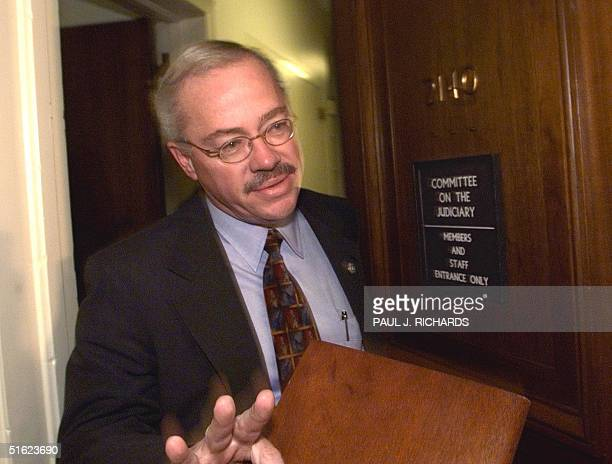 Rep Bob Barr enters a Republican Managers meeting late 13 January inside the House of Representatives Judiciary Committee office for final...