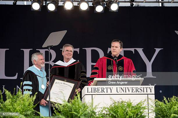 Rep Bob Goodlatte presents Republican US presidential hopeful and former Florida governor Jeb Bush with an honor degree as Liberty University...