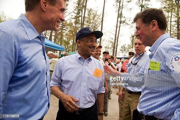 Rep. Bobby Scott, D-Va., center, greets former Senator George Allen, R-Va., right, as Sen. Mark Warner, D-Va., looks on during the 63rd Annual Shad...