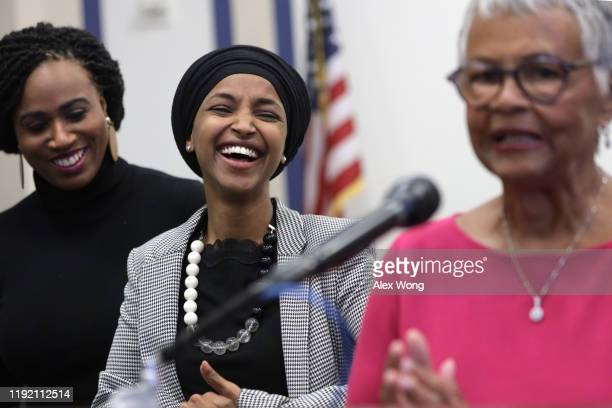 S Rep Bonnie Coleman Watson speaks as Rep Ayanna Pressley and Rep Ilhan Omar listen during a news conference December 5 2019 on Capitol Hill in...