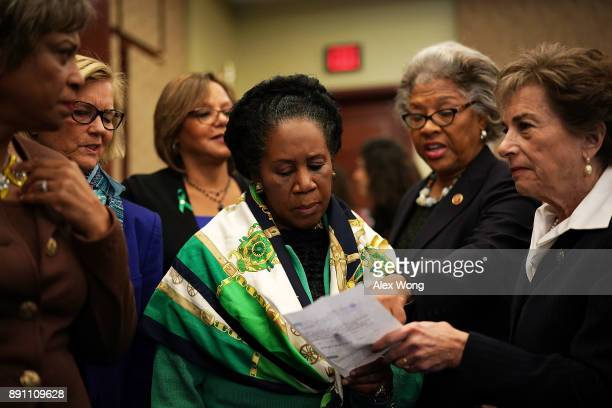 US Rep Brenda Lawrence Rep Chellie Pingree Rep Robin Kelly Rep Sheila JacksonLee Rep Joyce Beatty and Rep Jan Schakowsky discuss after a news...