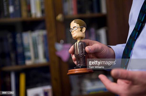 Rep Bruce Braley DIowa talks about a Dwight Schrute bobblehead during a tour of his office March 12 2010