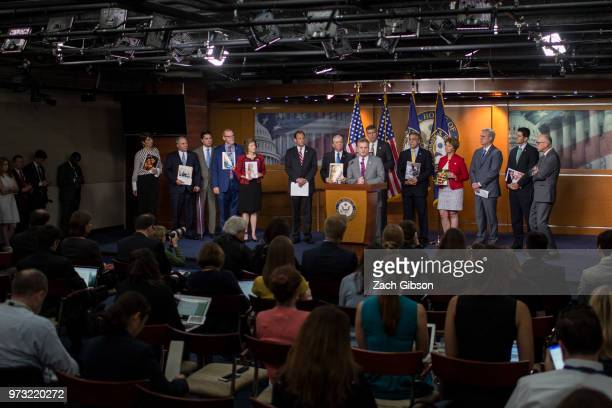 Rep Buddy Carter speaks as photographs are held up of people affected by the opioid epidemic during a news conference following a Republican...