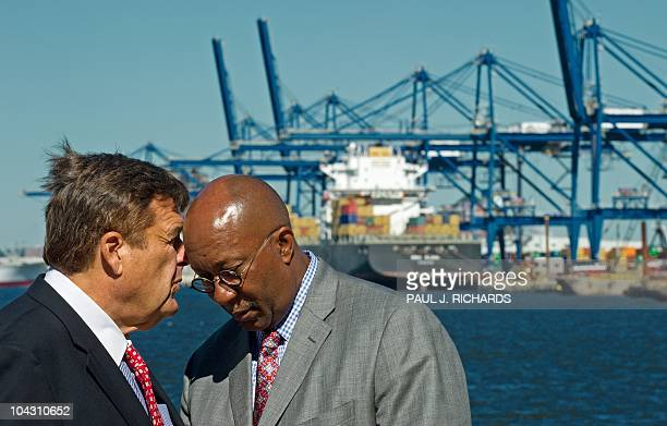 US Rep CA Dutch Ruppersberger speaks with US Trade Representative Ron Kirk shortly before both delivered remarks from the docks of Baltimore harbor...