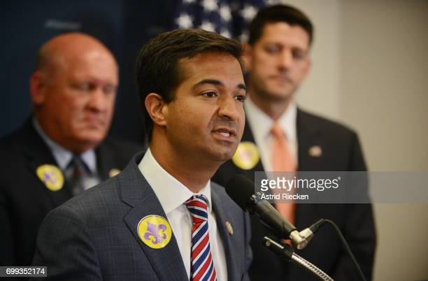 S Rep Carlos Curbelo flanked by US Rep Glenn Thompson and US Speaker of the House Rep Paul Ryan speaks during a press conference on Capitol Hill...