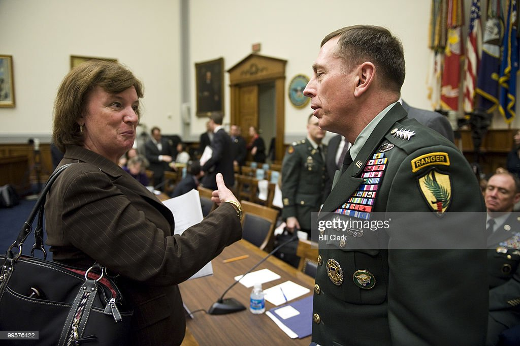 Rep. Carol Shea-Porter, D-N.H., speaks with Gen. David Petraeus, commander of the U.S. Central Command, during a break in the House Armed Services Committee hearing on the new strategy for Afghanistan and Pakistan on Thursday, April 2, 2009.