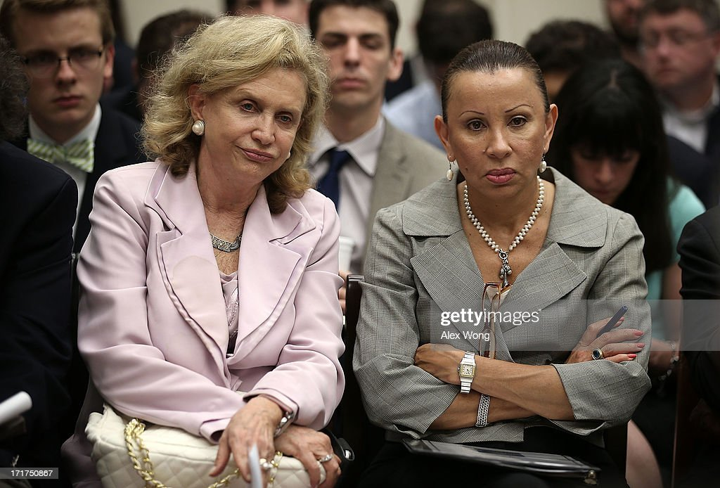 U.S. Rep. Carolyn Maloney (D-NY) (L) and Rep. Nydia Velazquez (D-NY) (R) listen during a discussion June 28, 2013 on Capitol Hill in Washington, DC. Rep. Maxine Waters (D-CA) held the discussion on 'A Way Forward For Housing Finance Reform: Finding Sustainable Solutions to Ensure Access, Affordability, and Taxpayer Protection Part II.'