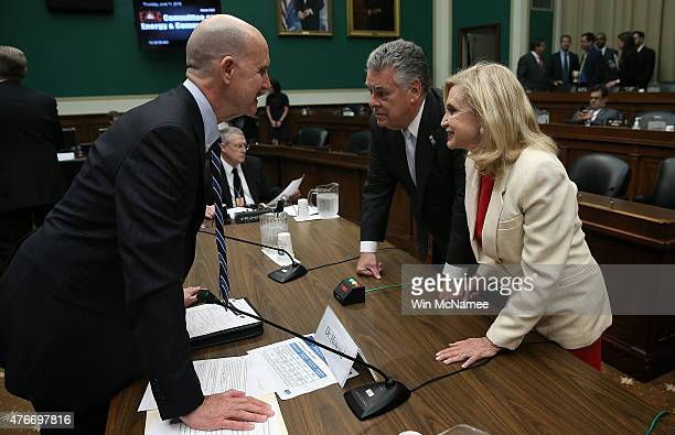 Rep Carolyn Maloney and Rep Peter King confer with Dr John Howard administrator of the World Trade Center Health Program prior to a hearing of the...