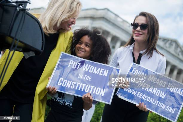 Rep Carolyn Maloney DNY left Avery HinesMuddy and actress Alyssa Milano attend a news conference at the House Triangle on the need to ratify the...