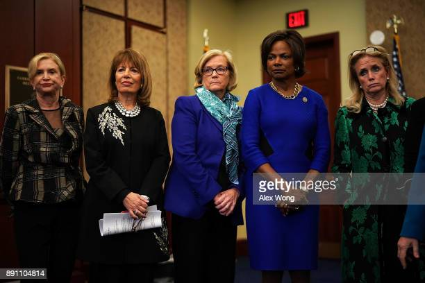 US Rep Carolyn Maloney Rep Jackie Speier Rep Chellie Pingree Rep Val Demings and Rep Debbie Dingell listen to a question during a news conference...