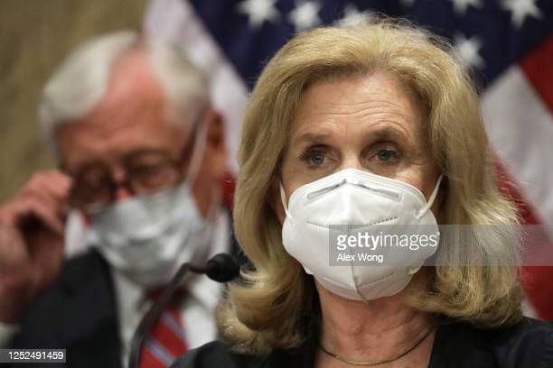 Rep. Carolyn Maloney speaks as House Majority Leader Rep. Steny Hoyer listens during a news conference on District of Columbia statehood June 25,...