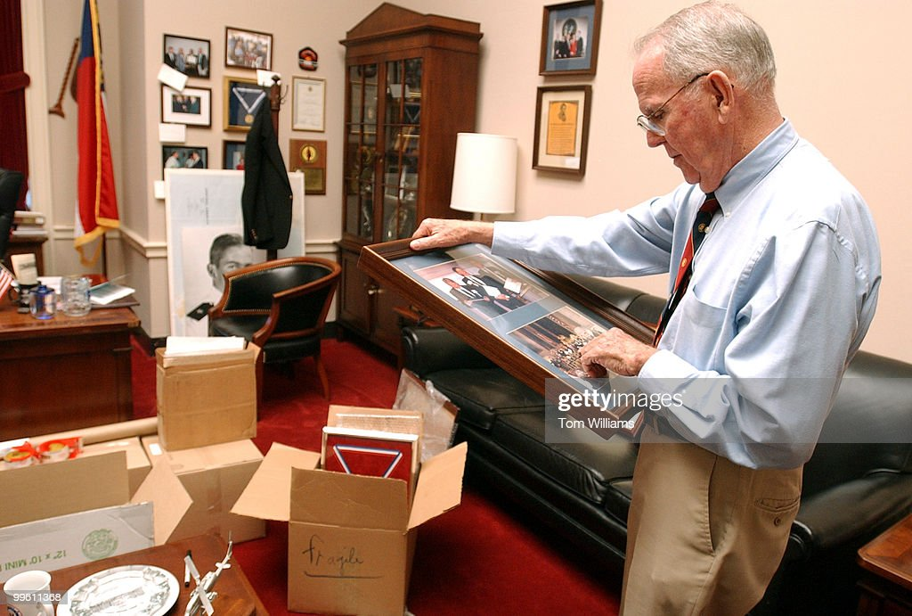 Rep. Cass Ballenger, R-N.C., packs up pictures in his office before his retirement. Ballenger served 9 terms in Congress.