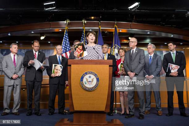 Rep Cathy McMorris Rodgers holds up a photograph of people in her district who have been affected by the opioid epidemic during a news conference...