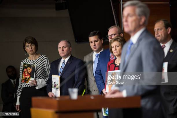 Rep Cathy McMorris Rodgers left and House Majority Whip Steve Scalise holding a photographs of people in their districts who have been affected by...