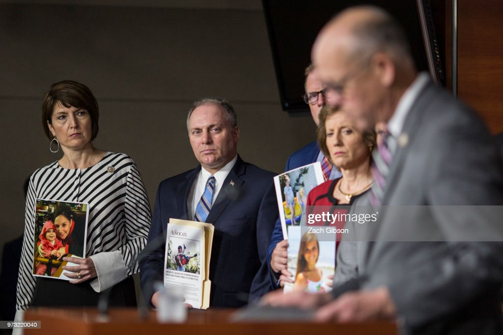 Rep. Cathy McMorris Rodgers (R-WA), left, and House Majority Whip Steve Scalise, (R-LA) (center), holding a photographs of people who have been affected by the opioid epidemic, listen as House Energy and Commerce Committee Chairman Rep. Greg Walden (R-OR) speaks during a news conference following a Republican Conference meeting on Capitol Hill on June 13, 2018 in Washington, DC.