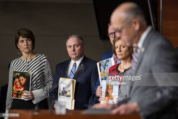 Rep Cathy McMorris Rodgers left and House Majority Whip Steve Scalise holding a photographs of people who have been affected by the opioid epidemic...