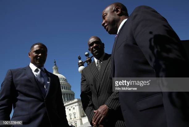 Rep Cedric Richmond Baseball Hall of Famer Andre Dawson and Sen Tim Scott speak before the start of a press conference outside the US Capitol July 18...