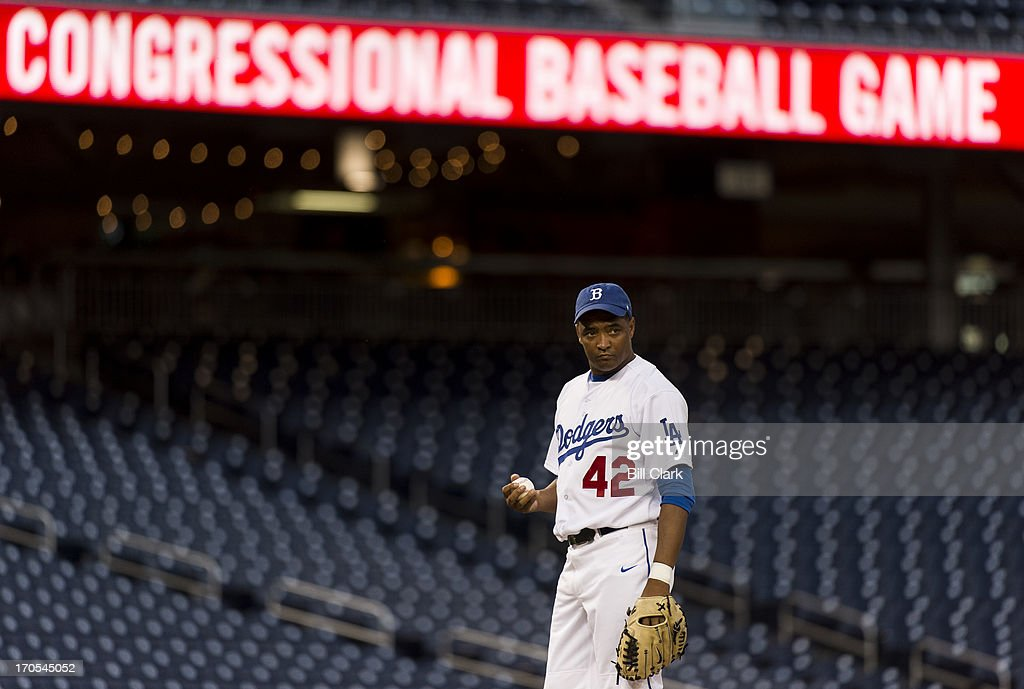 Rep. Cedric Richmond, D-La., takes a look at first as he pitches in the 52nd annual Congressional Baseball Game at national Stadium in Washington on Thursday, June 13, 2013.