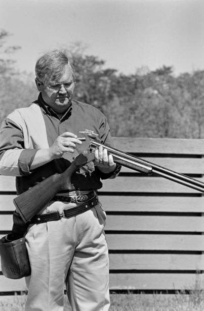 Representative Charlie Norwood loading rifle Pictures