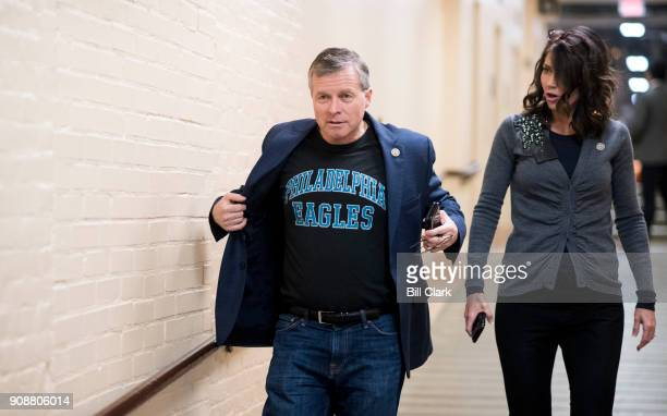 Rep Charlie Dent RPa flashes his Philadelphia Eagles shirt as Rep Kristi Noem RS Dak looks on as they arrive for the House Republican Conference...