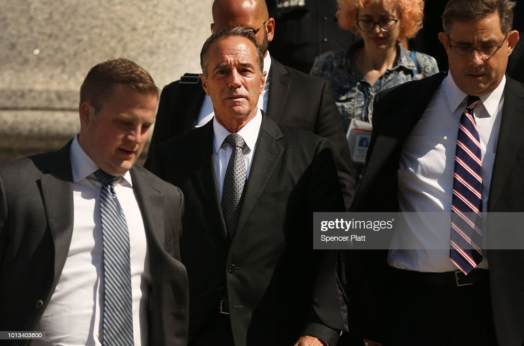 Rep. Chris Collins (R-NY) (2nd L) walks out of a New York court house after being charged with insider trading on August 8, 2018 in New York City. Federal prosecutors have charged Collins, one of President Trump's earliest congressional supporters, with securities fraud, accusing the congressman and his son of using inside information about a biotechnology company to make illicit stock trades.