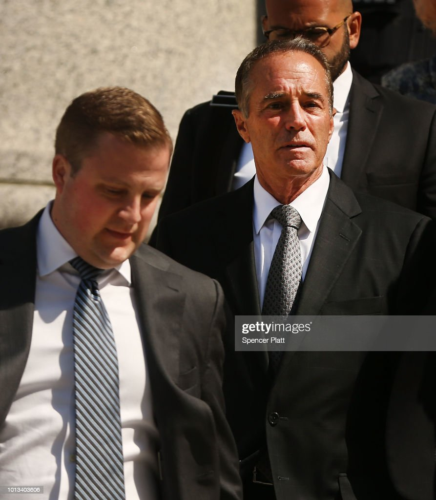 Rep. Chris Collins (R-NY) (R) walks out of a New York court house after being charged with insider trading on August 8, 2018 in New York City. Federal prosecutors have charged Collins, one of President Trump's earliest congressional supporters, with securities fraud, accusing the congressman and his son of using inside information about a biotechnology company to make illicit stock trades.