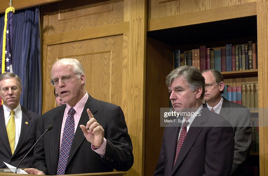 Rep. Chris Shays (R-CT), at poduum, with Rep. Martin T. Meehan (D-MA) encouraged the press to 'sit back and enjoy the (Enron) hearings,' during their news conference at the House Radio and TV Gallery Thursday morning.