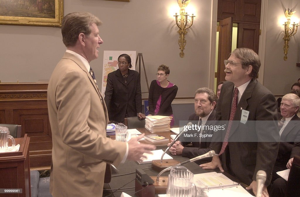 Rep. C.L. Otter (R-ID), left, jokes with Dr. Whitney of the United States Geological Survey (sitting) and Mr. Fulton, right, with the Department of the Interior at a hearing on 'The Orderly Development of Coalbed Methane Resources from Public Lands,' in the Longworth building on Thursday.