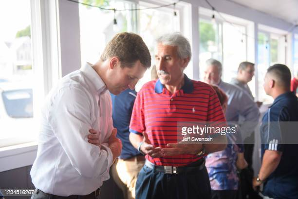 Rep. Conor Lamb talks with constituents at Riardos Bar and Grill on August 6, 2021 in New Castle, Pennsylvania. Lamb announced his candidacy for...