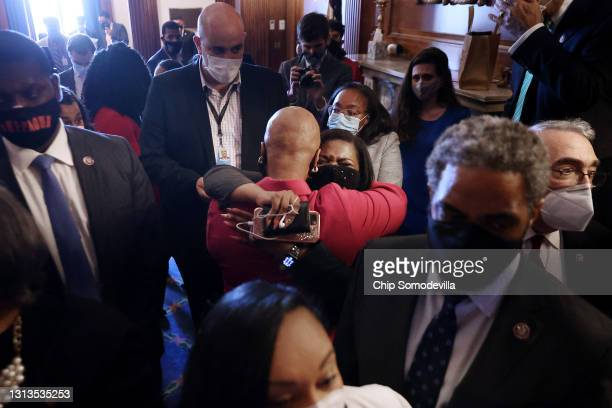 Rep. Cori Bush embraces Rep. Ayanna Pressley as members of the Congressional Black Caucus react to the verdict in the Derek Chauvin murder trial in...