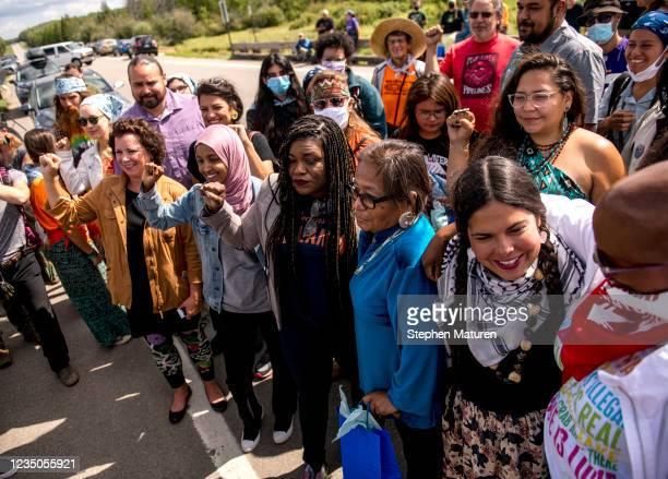 Rep. Cori Bush , Rep. Ilhan Omar , Rep. Ayanna Pressley , State Sen. Mary Kunesh , and Rep. Rashida Tlaib pose for a photo near the headwaters of the...