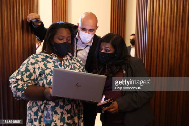 Rep. Cori Bush watches the announcement of the verdict in the Derek Chauvin murder trial with staff members in the Rayburn Room at the U.S. Capitol...