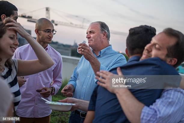 Rep Dan Kildee DMich attends an iftar dinner on a roof deck in Northeast for guests who participated in fasting for Ramadan June 20 2016 Muslims and...