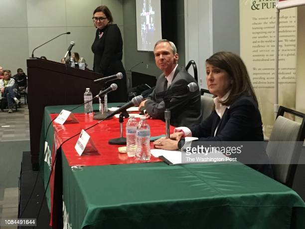 Rep Dan Lipinski center listens to primary opponent Marie Newman left at a February 21 debate