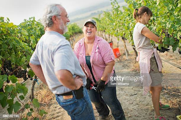 Rep Dan Newhouse RWash talks to his daughter Jensena in a grape vineyard on their farm outside of Sunnyside Wash August 27 2015 Jensena a Washington...