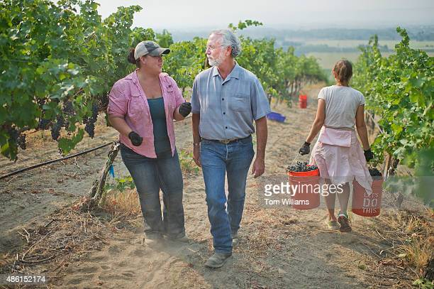 Rep Dan Newhouse RWash talks with his daughter Jensena in a grape vineyard on their farm outside of Sunnyside Wash August 27 2015 Jensena a...