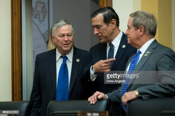 Rep Dana Rohrabacher Rep Darrell Issa and Rep Joe Wilson await the arrival of Thae Yongho former chief of mission at the North Korean embassy in the...