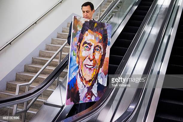 Rep Darrell Issa RCalif walks through the basement of the Capitol with a painting of Ronald Reagan by artist Steve Penley February 11 2015 The...