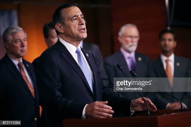 Rep Darryll Issa is joined by more than a dozen Republican members of Congress as he speaks during a news conference about the Deferred Action for...
