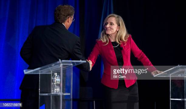 Rep Dave Brat RVa and his Democratic challenger Abigail Spanberger shake hands after the Virginia 7th Congressional district debate at the Germanna...
