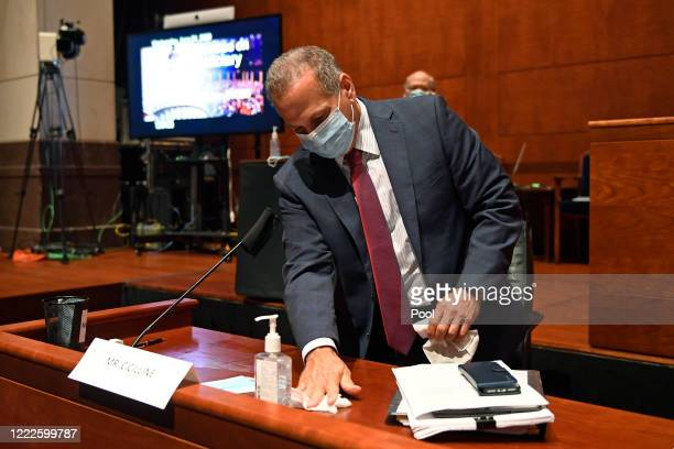 Rep David Cicilline wipes down his desk before the start of a House Judiciary Committee hearing on oversight of the Justice Department and a probe...