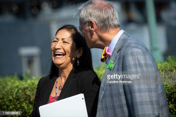Rep Deb Haaland DNM left talks with Rep Earl Blumenauer DOre before a news conference with ranchers supporting the Green New Deal and farm policy...
