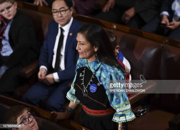 TOPSHOT Rep Deb Haaland stands during the 116th Congress and swearingin ceremony on the floor of the US House of Representatives at the US Capitol on...