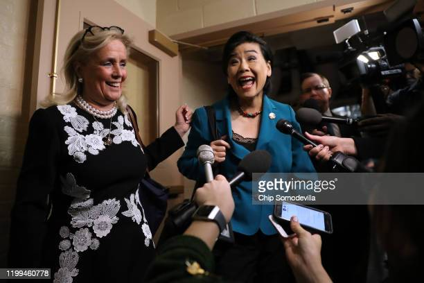 Rep. Debbie Dingell and Rep. Judy Chu talk to journalists as they arrive for the weekly House Democratic Caucus meeting in the basement of the U.S....