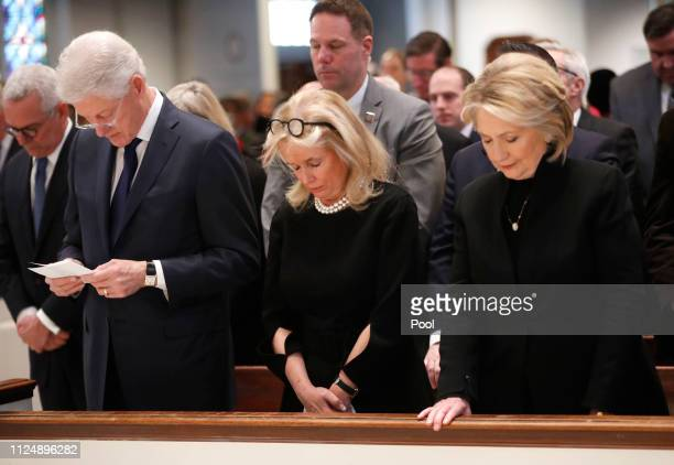 Rep. Debbie Dingell , center, bows her head with former U.S. President Bill Clinton and former Secretary of State Hillary Clinton during funeral...
