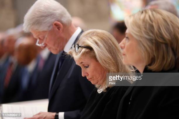 Rep. Debbie Dingell , center, stands with former U.S. President Bill Clinton and former Secretary of State Hillary Clinton during funeral services...